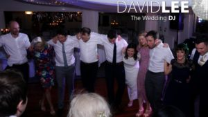 Bride and guests dancing to the last song of the night