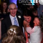 Bride and family dancing